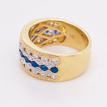 Blue Sapphire and Diamond 14 Karat Yellow and White Gold Cigar Band Ring