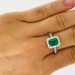 Emerald and Diamond Halo Engagement Ring in 14k gold