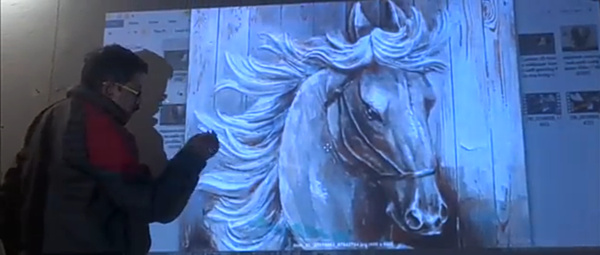 Artist using projector for projection mapping