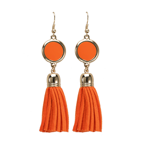 Orange suede tassel earrings with gold accents and enamel disk for monogramming.