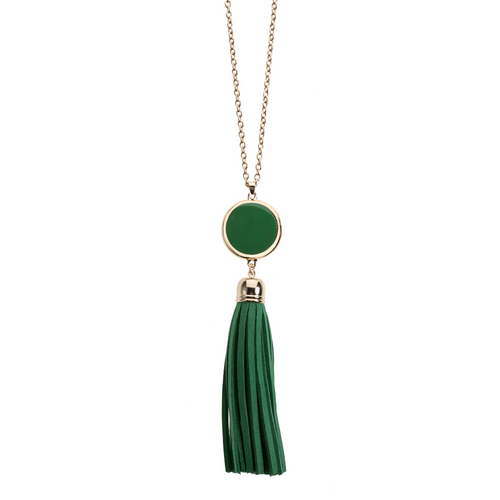 Green suede tassel necklace with gold accents and enamel disk for monogramming.