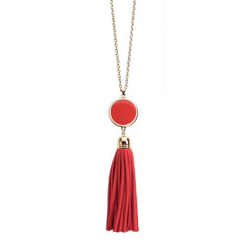 Red suede tassel necklace with gold accents and enamel disk for monogramming.