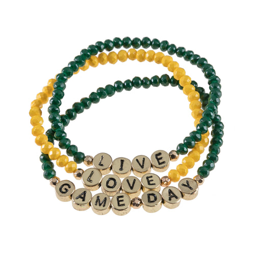 "Set of 3 green and yellow beaded stretch bracelets with gold beads that say ""live, laugh, gameday."""