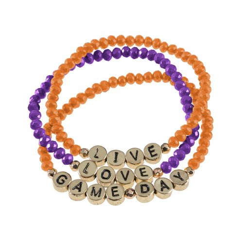 "Set of 3 maroon and yellow beaded stretch bracelets with gold beads that say ""live, laugh, gameday."""