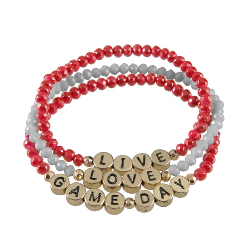"Set of 3 maroon and black beaded stretch bracelets with gold beads that say ""live, laugh, gameday."""