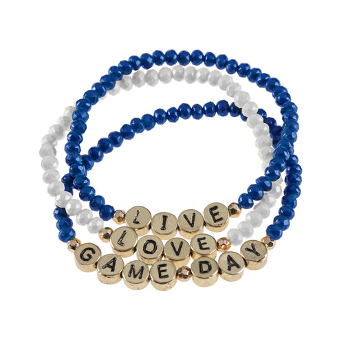 "Set of 3 purple and yellow beaded stretch bracelets with gold beads that say ""live, laugh, gameday."""