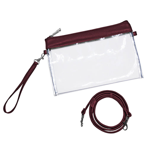 Clear stadium approved zipper pouch with maroon trim and comes with one wristlet strap and one shoulder strap.