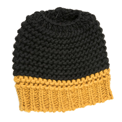 Black and yellow knitted bun hat.