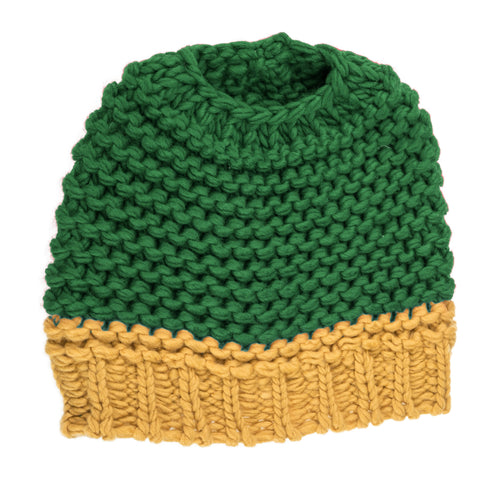 Green and yellow knitted bun hat.