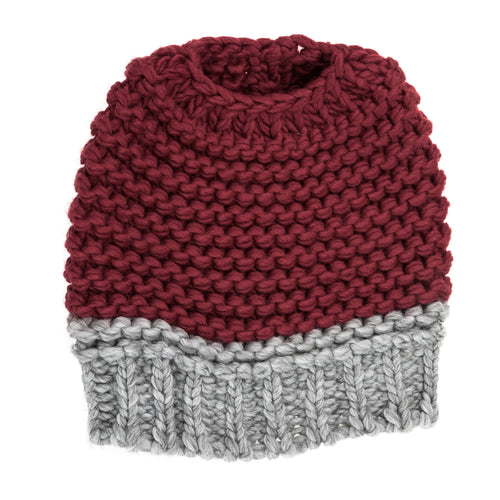 Maroon and light grey knitted bun hat.