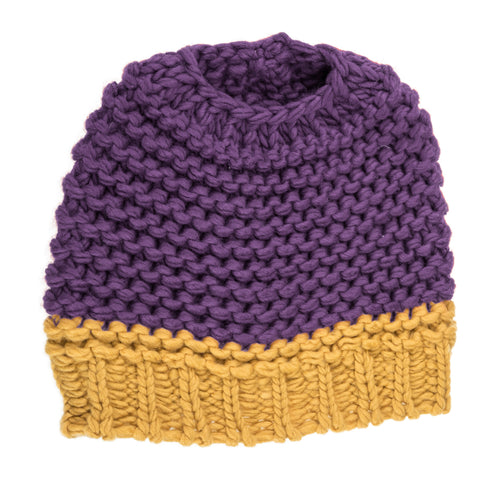 Purple and yellow knitted bun hat.