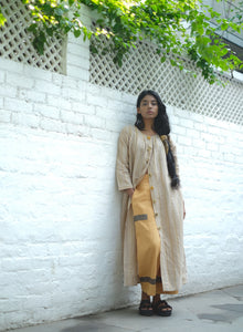 DESERT STONE NECK PLEATED DRESS