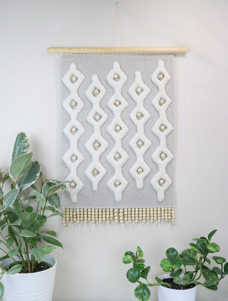 Sculpted tapestry with wooden beads