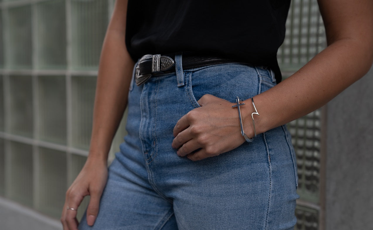 woman wearing silver wave bracelet