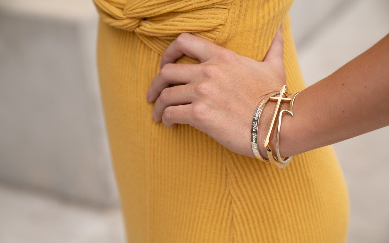 woman wearing 14K gold vermeil cross bracelet