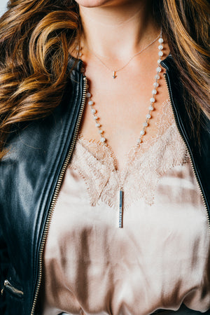 woman wearing modern silver anchor necklace