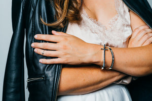 woman wearing sterling silver cuff cross bracelet