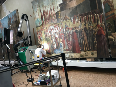 Restorer at work on this paining in the St Ursula Cycle, 4/27/2018