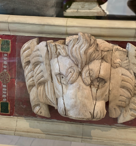 Lions head carved in bone inlaid on frame