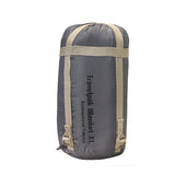 Snugpak Travelpak Pebble Grey Travel Blanket in its Stuff Sack