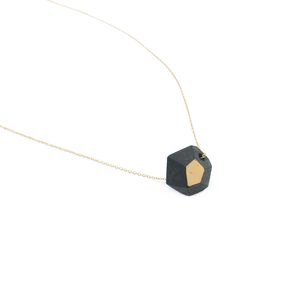 black-and-gold-faceted-bead-layering-necklace-on-gold-chain