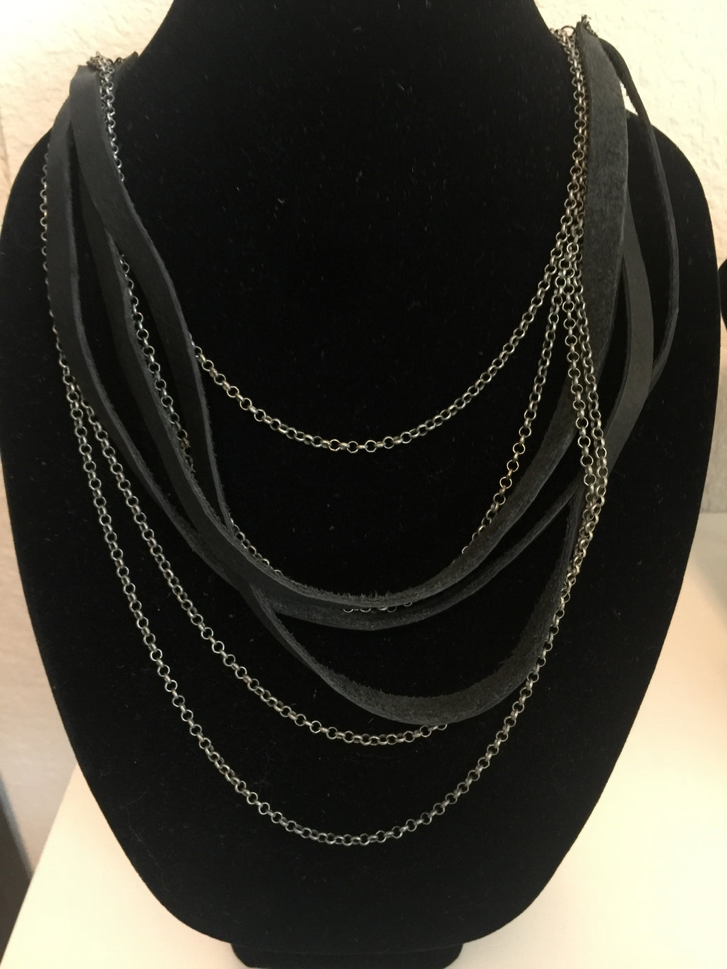 Layered chain and leather necklace