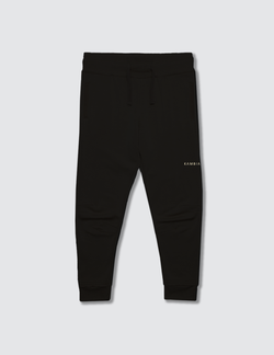 Black sweatpant made out of recycled cotton with two darts on the front of the knee with a non functional drawstring for kids safety