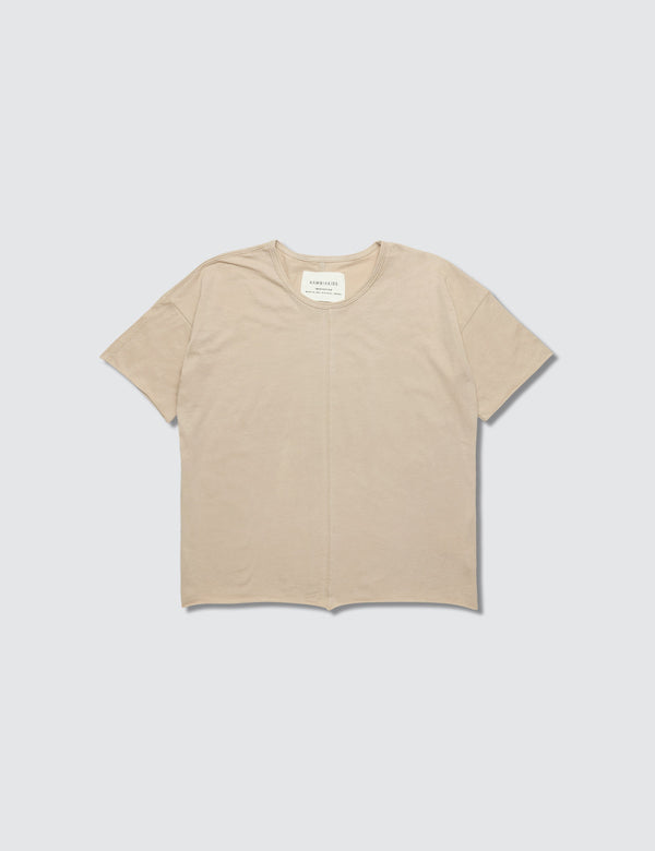 Tan crewneck short sleeve tee made out of recycled cotton with a seam down the front middle