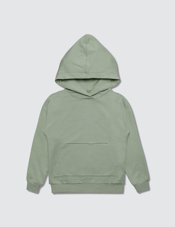 Light green hoodie made out of recycled bamboo with the Kambia Kids logo embroidered on the back