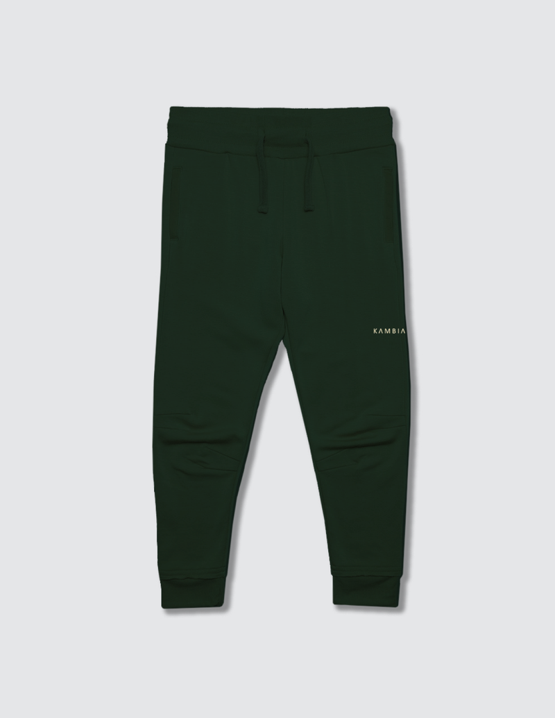 Dark forest green sweatpant made out of recycled cotton with two darts on the front of the knee with a non functional drawstring for kids safety