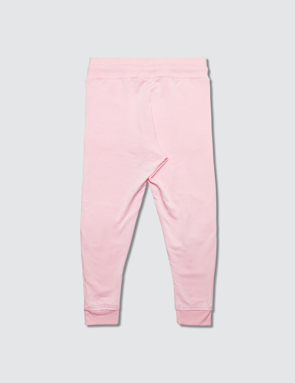 Pink sweatpant made out of recycled bamboo with two darts on the front of the knee with a non functional drawstring for kids safety