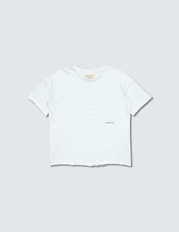 A white crewneck short sleeve with dots printed on the front for kids to color in their own design.