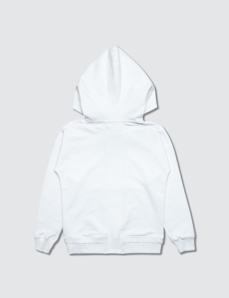 A white sweatshirt made out of recycled cotton with dots printed on the front for kids to color in their own design.