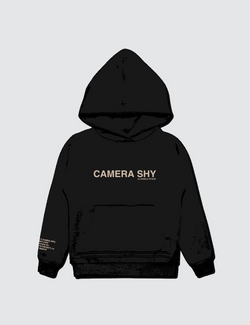 A black hoodie from recycled cotton with the words Camera Shy printed on the front.
