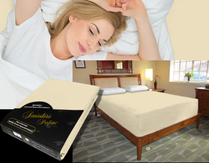 Lady in bed on stretch sheet in color 26-Sand, bed with deep mattress with Jersey knit stretch sheet in color 26-Sand