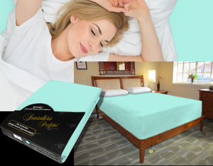 Lady in bed on stretch sheet in color 33-Mint, bed with deep mattress with Jersey knit stretch sheet in color 33-Mint