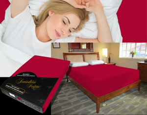 Lady in bed on stretch sheet in color 37-Red, bed with deep mattress with Jersey knit stretch sheet in color 37-Red