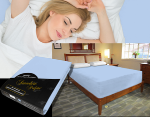 Lady in bed on stretch sheet in color 39-Bleu, bed with deep mattress with Jersey knit stretch sheet in color 39-Bleu