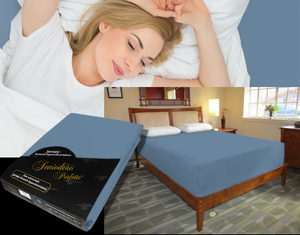 Lady in bed on stretch sheet in color 40-Azure, bed with deep mattress with Jersey knit stretch sheet in color 40-Azure