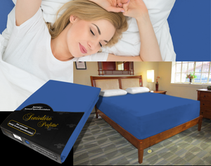 Lady in bed on stretch sheet in color 41-Ocean Blue, bed with deep mattress with Jersey knit stretch sheet in color 41-Ocean Blue