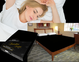 Lady in bed on stretch sheet in color 43-Black, bed with deep mattress with Jersey knit stretch sheet in color 43-Black