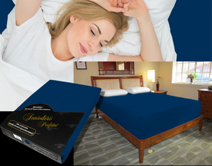 Lady in bed on stretch sheet in color 44-Dark-Navy, bed with deep mattress with Jersey knit stretch sheet in color 44-Dark-Navy
