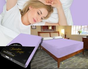Lady in bed on stretch sheet in color 46-Lilac, bed with deep mattress with Jersey knit stretch sheet in color 46-Lilac