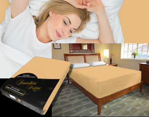 Lady in bed on stretch sheet in color 47-Caramel, bed with deep mattress with Jersey knit stretch sheet in color 47-Caramel