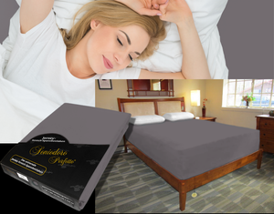 Lady in bed on stretch sheet in color 48-Graphite, bed with deep mattress with Jersey knit stretch sheet in color 48-Graphite