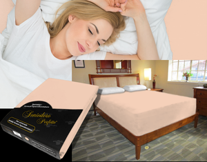Lady in bed on stretch sheet in color 49-Apricot, bed with deep mattress with Jersey knit stretch sheet in color 49-Apricot