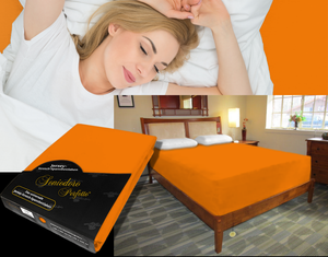 Lady in bed on stretch sheet in color 50-Orange, bed with deep mattress with Jersey knit stretch sheet in color 50-Orange