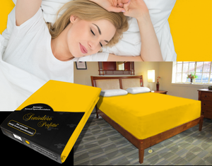 Lady in bed on stretch sheet in color 67-Gold, bed with deep mattress with Jersey knit stretch sheet in color 67-Gold