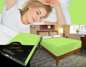 Lady in bed on stretch sheet in color 68-green apple, bed with deep mattress with Jersey knit stretch sheet in color 68-green apple