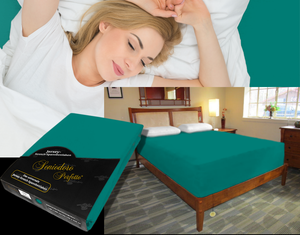 Lady in bed on stretch sheet in color 53-Evergreen, bed with deep mattress with Jersey knit stretch sheet in color 53-Evergreen